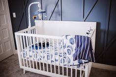 Modern Space-themed Nursery by Ashley Opliger | Baby boy nursery with focal accent wall. #nurserygoals #babyboynursery #boynursery #focalwall #modernnursery #diynursery #spacenursery #nurserydesign #nurseryideas #nurserydecoration #nurseryinspiration #interiorstyling #interiordesigninspiration #fixerupper #shiplap #shiplapwalls #joannagaines #modernfarmhouse #magnoliahome #farmhousedecor #homedecorcommunitylove #modernfarmhousehome #betterhomesandgardens #modernfarmhousestyle Space Themed Nursery, Nursery Themes, Nursery Decor, Nursery Inspiration, Interior Design Inspiration, Modern Farmhouse Style, Farmhouse Decor, Focal Wall, Ship Lap Walls