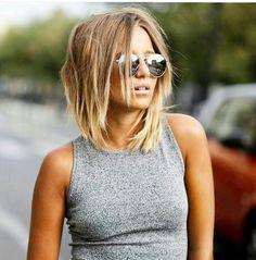 Shaggy shoulder length hair More