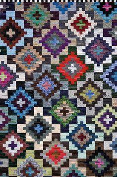 An example of The Amazing Matrix rug, designed by Jennifer Manuell (Fish Eye Rugs)