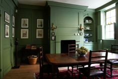 The bolder side of the hemlock shade spectrum saturates a traditional room with a detail-defining green. Shown here: Calke Green No. 34, Farrow & Ball. | Photo: Courtesy of Farrow & Ball