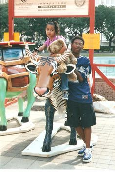 2001 Cow Parade with the Jungle Cow. Lady Austin with Cuz Jon. Houston Texas