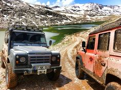 """Land Rover Defenders. """"Father schools son in mud relations"""" - WEH"""