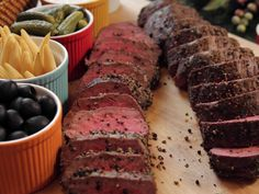 Easy, elegant beef tenderloin needs nothing more than olive oil and crushed peppercorns to set off its rich flavor.