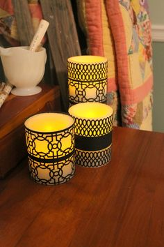 Punched Candle Wraps. Punch black card stock with various paper punches to make simple yet elegant wraps for your candles.