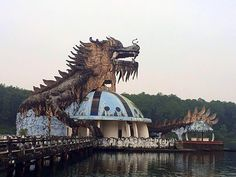 The creepy, abandoned water park/aquarium in Huong Thuy town of Hue, Vietnam. The pool under this dragon was filled with black crocodiles that the park's owners abandoned when they closed the park. They were recently rescued and taken to a nature preserve.