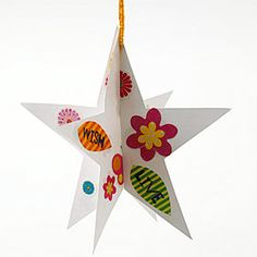 Easy Indoor Crafts for Kids...Hanging Stars  Download our star template below. Cut out two star shapes from card stock. Slit one star from the top point to the middle and the second from the bottom to the center point. Adorn each star with leftover buttons, gems, and stickers. Slide the two stars together, punch a hole at the top, and thread ribbon through the hole for hanging.