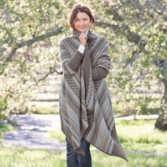 """FOUR CORNERS DRAPED CARDIGAN--You'll toss our striking sweater over everything, from jeans to a simple black dress. Cushy cotton is knitted in western inspired patterns on this popular draped silhouette, with deep ribknit at sleeves and hem. Imported. Exclusive. Sizes XS (2), S (4 to 6), M (8 to 10), L (12 to 14), XL (16). Approx. 40""""L."""