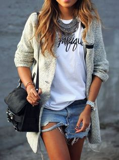 classy casual shorts - distressed denim cutoff shorts, oversize drapey graphic tee, statement necklace and watch, long tweed blazer jacket, and black leather / calf hair purse