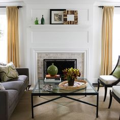 simple wooden surround painted white dresses up any fireplace. Brick also draws attention to the fireplace. Here, the mantel was raised to match the height of the draperies, adding another level of interest to the room.