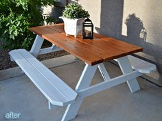Love this sophisticated take on a picnic table... white legs and benches, stained top!