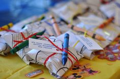 cookies wrapped up and tied with ribbon/crayon-cute for kids party favors