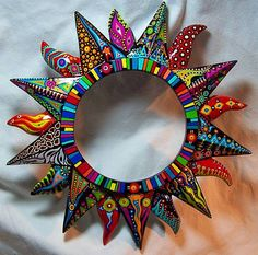 psychedelic sun art: wondering if this is papier mache around a mirror?psychedelic sun art - love this! Started with paper mache'.multicolour sun art in Polymer Claypsychedelic sun art by betsy. very Modern Mirror Ideas >> For More Modern Mirr