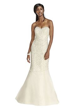You ll be a flawlessly beautiful bride as you walk down the aisle in this crystal beaded tulle gown! Fitted strapless sweetheart bodice features intricate crystal beading for an ultra-glamorous look. ...