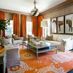 Living Room - An equestrian theme in the spacious well furnished room with pops of orange against a muted palette.