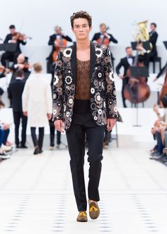 Burberry Spring/Summer 2016. Leather applique and whipstitch detailing on a tailored wool mohair jacket with black tailored trousers