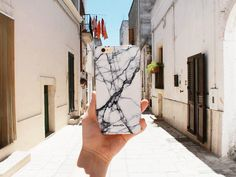 White Marble iPhone Cover by Madotta | This chic marble design is now available for iPhone 7, 7 Plus, 6 / 6s, 6 Plus / 6s Plus, 5s / 5C, SE plus some Samsung Galaxy S devices. Exclusive Design. Printed in the UK. International shipping available. Fashionable iPhone 7 Cases  #madotta Shop now at https://madotta.com/collections/marble-iphone-cases/?utm_term=caption+link&utm_medium=Social&utm_source=Pinterest&utm_campaign=IG+to+Pinterest+Auto