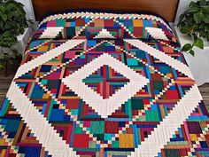 Home Sweet Home Log Cabin Quilt. Wonderful complicated variation on the classic Log Cabin design. Superb fabric selections with delightful bright coloring Very well made by an Amish woman.