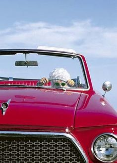 Here she comes just a drivin' down the street .. singin' doo a diddy diddy dum diddy doo...