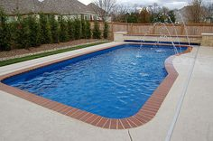 Moroccan model Leisure fiberglass pool with automatic cover. See how the cover is hidden under the planter box. Great idea for both new and existing fiberglass pools. Really nice Midwest Custom Pools!