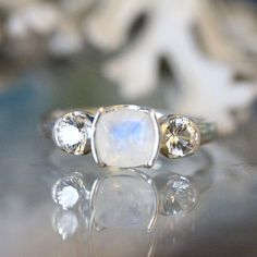 Sweet little moonstone ring. The faceted cut really enhances this stone's rainbow sparkles! No other stone is quite like it…seems to glow softly