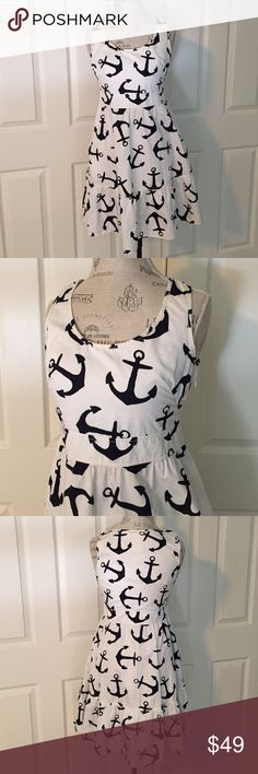 "Flash SaleJ. Crew Dizzy Anchors Dress cute and classic nautical themed ""Dizzy Anchors"" dress from J Crew. 100% cotton. features pockets and size zipper. very good pre-loved condition but please see last photo for 1/2"" section near zipper that coming unstitched and also a faint 3/4"" spot near hem - not noticeable. 6F2244 J. Crew Dresses"