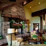 This fireplace on FrontDoor.com envelopes the living room with rustic stonework and a hardwood mantel featuring a custom lighting design. | HGTV FrontDoor-love that fireplace ...