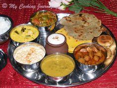 Rajasthani Thaali - SNC - baati, Bajiri ki roti, Bread, Complete meal platter, Dal, dhana wadi, Gatte ki kadhi, Goond ki Laddu, Laddu, Lassi, Makki ki roti, moong wadi, North Indian, Rajasthan, Rajasthani thali, SNC Uncategorized 30th July, 2013 I am part of this wonderful group called South North Challenge, started by Divya Pramil of You too Can cook. I belong to the Southern team
