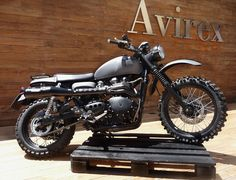 Triumph Scrambler.  Please, somebody out there love me enough to buy me one!