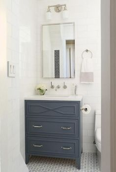 Blue Single Washstand with White and Gray Mosaic Floor Tiles