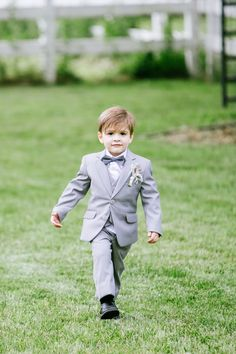 The sweetest little ring bearer: http://www.stylemepretty.com/illinois-weddings/chicago/2016/04/13/a-bohemian-horse-farm-wedding-oozing-with-personal-style/ | Photography: Averyhouse - http://galleries.averyhouse.net/