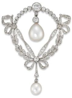 A Belle Époque brooch - c1900 - composed of natural pearls, diamonds,  and platinum.