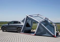 Inflatable Audi Q3 camping tent - vehicle can integrate with tent to form larger living space //