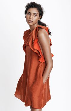 Burnt orange dress with texture and definitely-not-frilly ruffles.