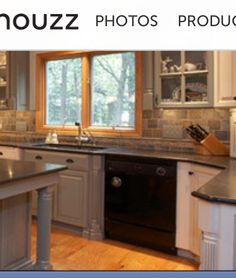 Another angle, love the backsplash as well as the gray & white cabinets with the dark countertops