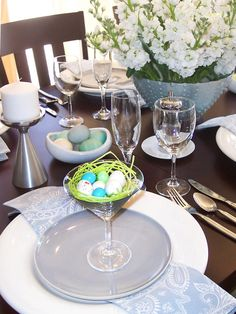 Cute idea using martini glasses to hold nests. A Nod to Mod - Easter Table Settings and Centerpieces on HGTV