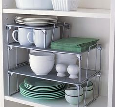 Stack shelves to make use of head room in this kitchen cabinet idea for organization.