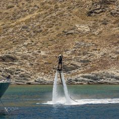 Waterboarding - Mykonos July 30th - Man flyboarding off the coast of Mykonos. Mykonos Greece July 30th 2016