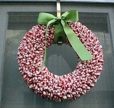 Cheap peppermints + glue gun + styrofoam wreath= cute decoration!!  Jellybeans for Easter, candy corn for Halloween, so many possibilities!