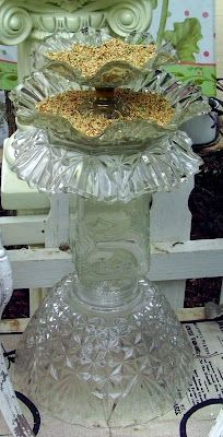 bird bath made out of a punch bowl, canister, and light fixture.