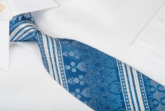 Stylish Rhinestone silk necktie perfect for every occasion, handmade and designed by top brand name Nina Ricci. Presenting an elegant design with white stripes and Cartouche on blue woven silk and sparkling with crystal Rhinestones and gold sparkles.