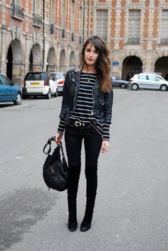 Striped top, black jeans, leather jacket.