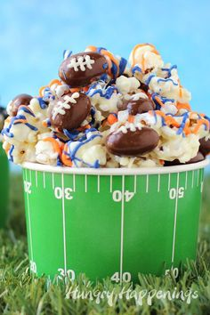 White Chocolate Football Popcorn - CountryLiving.com
