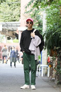 Street Style of Tokyo: PALACE Sweatshirt, Supreme Pants, STUSSY Bag, CONVERSE Shoes | Fashionsnap.com