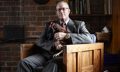 Joel Salatin, farmer. If I don't look like john muir one day i'll probably look like joel salatin. or at least id like to wear a suit and sit in a cool chair like that holding one of my chickens.