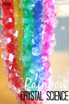 Crystal rainbow science growing borax crystals with pipe cleaners. Makes a fun STEAM project designing a rainbow to grow crystals. Explore chemistry with kids using a saturated solution. Also makes a fun St Patrick's Day science activity for kids.