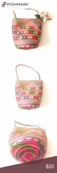 """Straw Bucket Bag Adorable tote that is perfect for summer! Straw basket tote in pink, purple, green, and natural. Approx measurements: 12"""" length (not including handle), 12.75 width at top, 8.75"""" width at bottom.   •lowball offers declined •no trades •ask all questions before buying •unfair ratings from buyers are reported & buyer will be blocked - I don't misrepresent my products; what you see is exactly what you get & my prices are fair. Please be kind as I always strive to be kind to you…"""