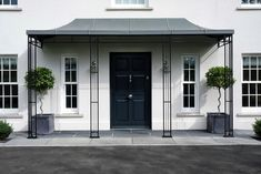 Perfectly framing the door and windows of this stylish entrance. Modern Porch, Wrought Iron Gates, Bespoke Design, Simple Elegance, Porches, Service Design, Entrance, Exterior, Windows