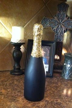 Champagne bottle painted with acrylic paint and glitter as a guest book