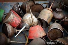 Vintage Oil Cans by Oseland, via Dreamstime