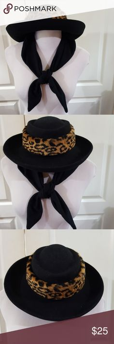 Dennis Basso (QVC) Hat w/Attached/Removable Scarf Awesome chic wool hat with attached black scarf and faux fur by Dennis Basso from QVC.  Black wool with black and tan animal print trim  as shown in photos. The scarf is attached with Velcro and stays put when you want to wear it, but is easy to remove when you want to wear it scarf-less. No holes, stains, flaws. Good condition. It has some lint on it but I don't see any flaws. Zoom in on pics to see it's condition for yourself. Very nice…